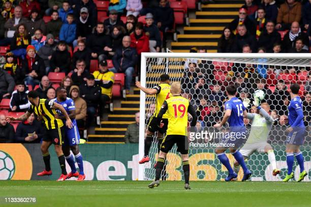 Troy Deeney of Watford scores his sides first goal during the Premier League match between Watford FC and Leicester City at Vicarage Road on March 03...