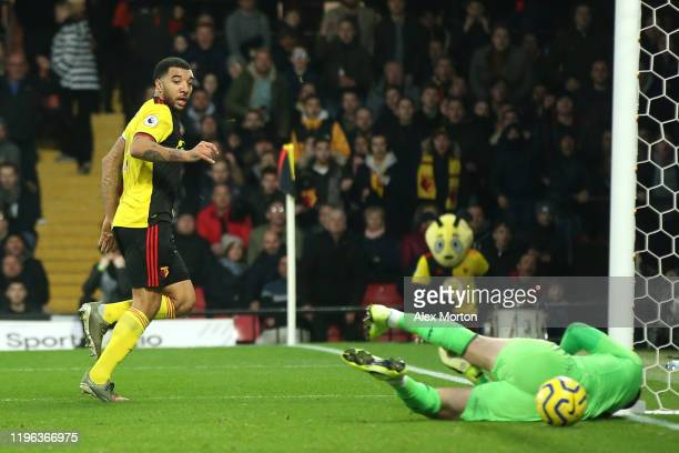 Troy Deeney of Watford scores his sides first goal during the Premier League match between Watford FC and Aston Villa at Vicarage Road on December...