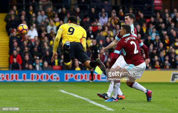Troy Deeney of Watford scores his sides first goal during the Premier League match between Watford and Burnley at Vicarage Road on February 4 2017 in...