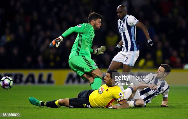 Troy Deeney of Watford scores his sides first goal past Ben Foster of West Bromwich Albion during the Premier League match between Watford and West...