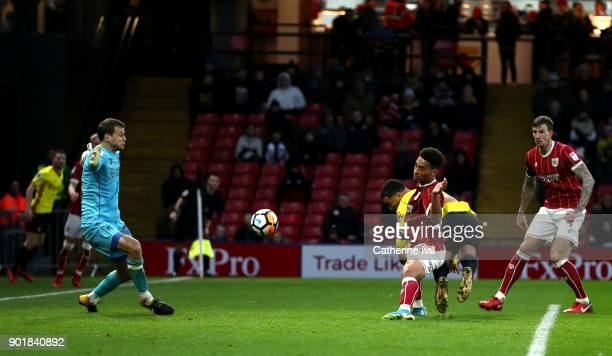 Troy Deeney of Watford scores his sides second goal during The Emirates FA Cup Third Round match between Watford and Bristol City at Vicarage Road on...