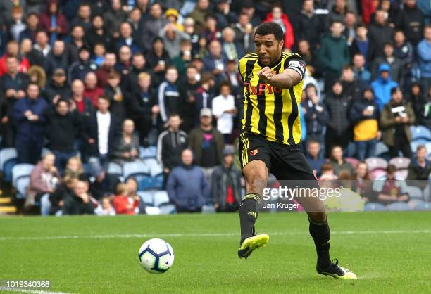Troy Deeney of Watford scores his sides second goal during the Premier League match between Burnley FC and Watford FC at Turf Moor on August 19 2018...
