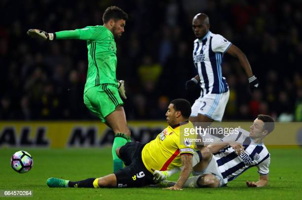 Troy Deeney of Watford scores his sides second goal past Ben Foster of West Bromwich Albion during the Premier League match between Watford and West...