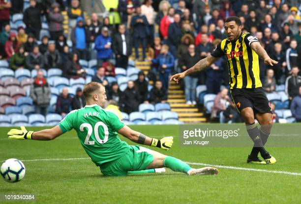 Troy Deeney of Watford scores his sides second goal past Joe Hart of Burnley during the Premier League match between Burnley FC and Watford FC at...