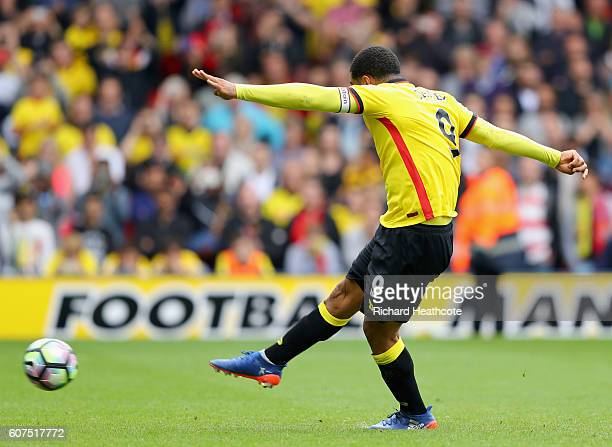 Troy Deeney of Watford scores his sides third goal during the Premier League match between Watford and Manchester United at Vicarage Road on...