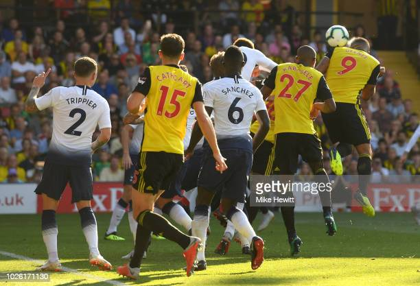Troy Deeney of Watford scores his team's first goal during the Premier League match between Watford FC and Tottenham Hotspur at Vicarage Road on...