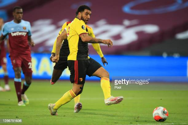 Troy Deeney of Watford scores his team's first goal during the Premier League match between West Ham United and Watford FC at London Stadium on July...