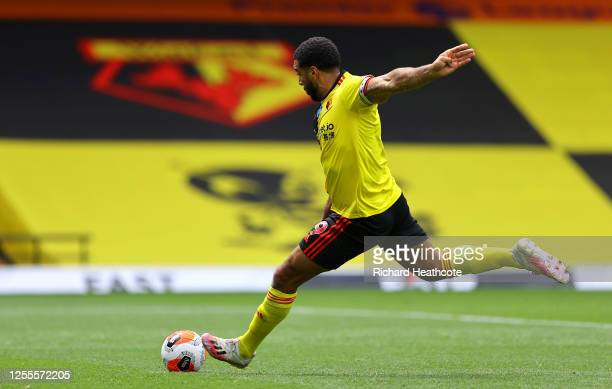 Troy Deeney of Watford scores his team's first goal from a penalty during the Premier League match between Watford FC and Newcastle United at...