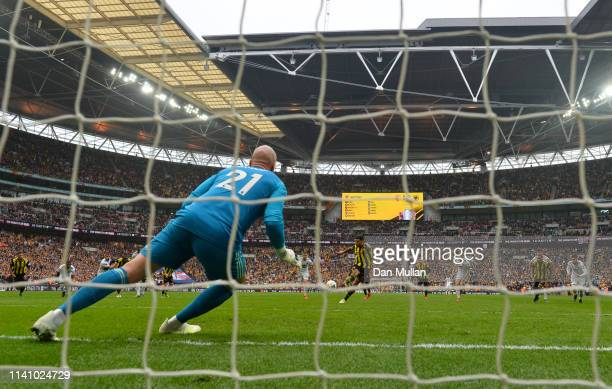 Troy Deeney of Watford scores his team's second goal from a penalty past John Ruddy of Wolverhampton Wanderers during the FA Cup Semi Final match...