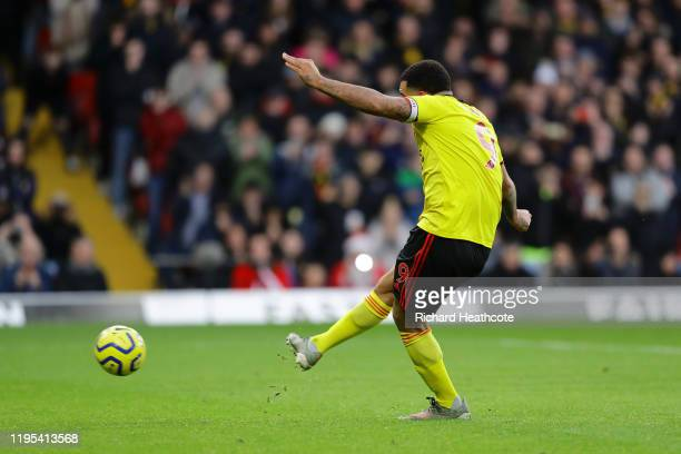 Troy Deeney of Watford scores his team's second goal from the penalty spot during the Premier League match between Watford FC and Manchester United...