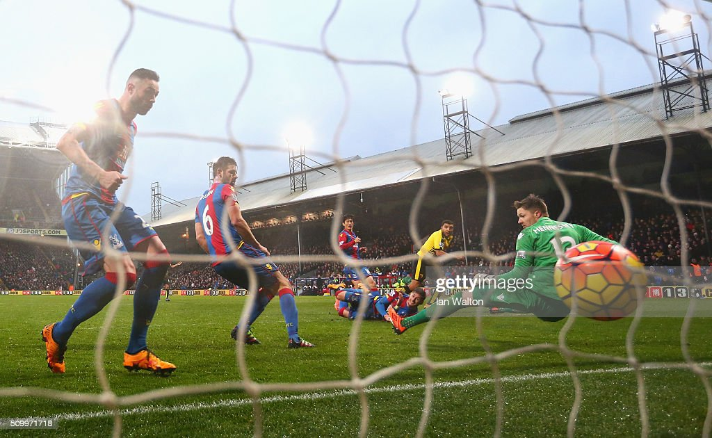 Troy Deeney of Watford scores his team's second goal past Wayne Hennessey of Crystal Palace during the Barclays Premier League match between Crystal Palace and Watford at Selhurst Park on February 13, 2016 in London, England.