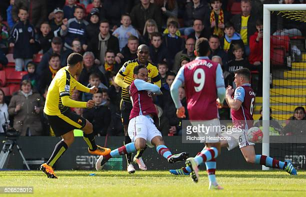 Troy Deeney of Watford scores his team's third goal during the Barclays Premier League match between Watford and Aston Villa at Vicarage Road on...