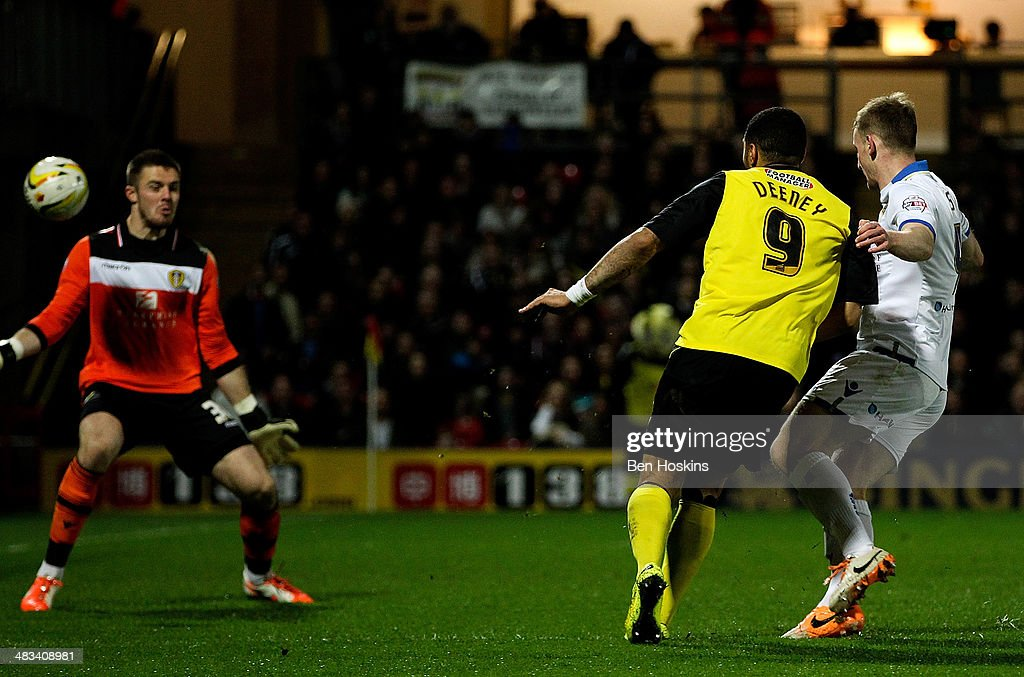 Troy Deeney (C) of Watford scores his team's third goal of the game during the Sky Bet Championship match between Watford and Leeds United at Vicarage Road on April 8, 2014 in Watford, England.