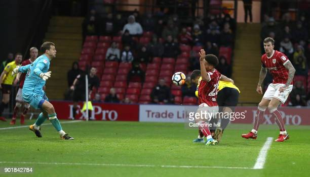 Troy Deeney of Watford scores the 2nd Watford goal during The Emirates FA Cup Third Round match between Watford and Bristol City at Vicarage Road on...