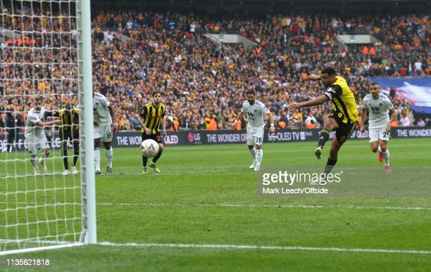 Troy Deeney of Watford scores the equalising goal from the penalty spot during the FA Cup Semi Final match between Watford and Wolverhampton...