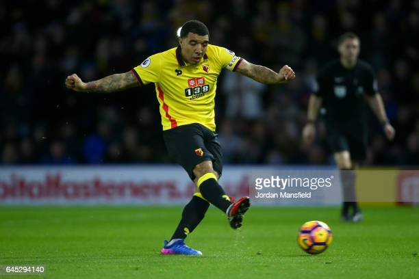 Troy Deeney of Watford scores the first goal from a penalty during the Premier League match between Watford and West Ham United at Vicarage Road on...