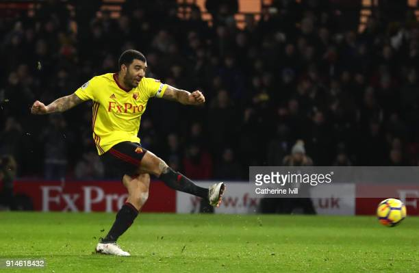 Troy Deeney of Watford scores the first goal from the penalty spot during the Premier League match between Watford and Chelsea at Vicarage Road on...