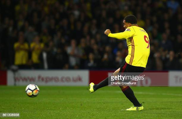 Troy Deeney of Watford scores their first and equalising goal from the penalty spot during the Premier League match between Watford and Arsenal at...