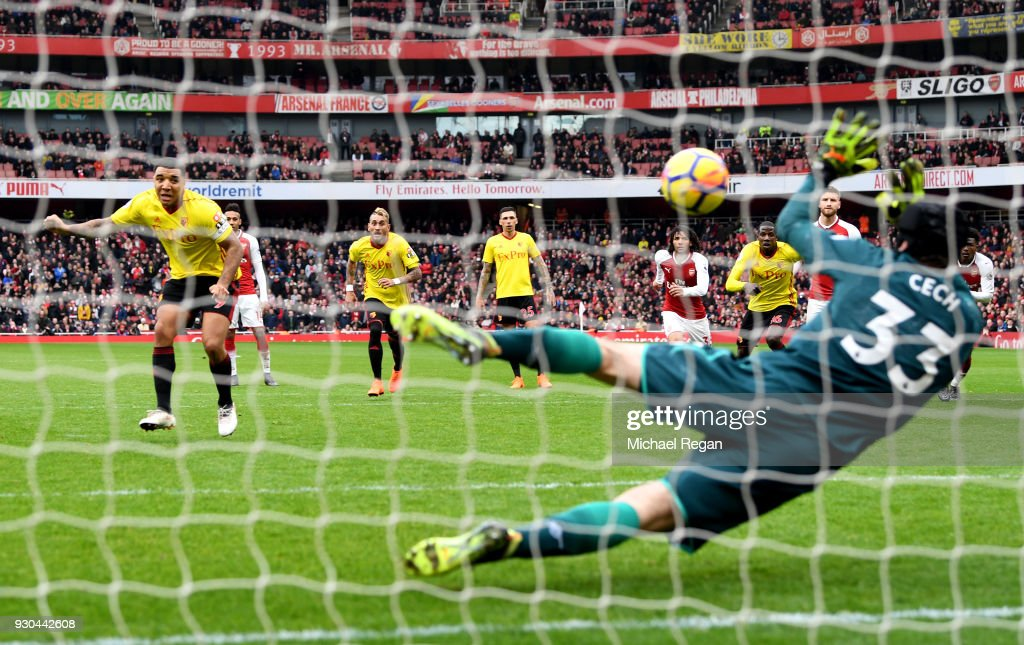 Troy Deeney of Watford sees his penalty saved by Petr Cech of Arsenal during the Premier League match between Arsenal and Watford at Emirates Stadium on March 11, 2018 in London, England.