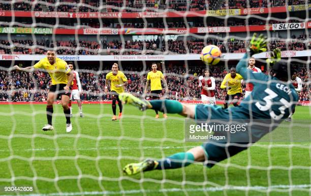 Troy Deeney of Watford sees his penalty saved by Petr Cech of Arsenal during the Premier League match between Arsenal and Watford at Emirates Stadium...