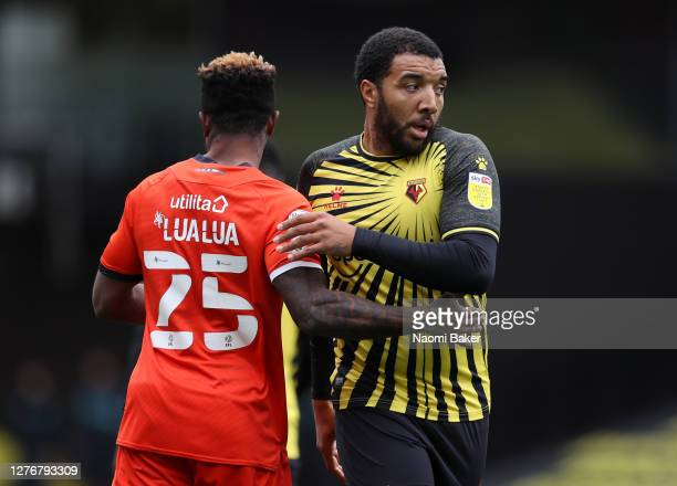 Troy Deeney of Watford shakes hands with Kazenga LuaLua of Luton Town following the Sky Bet Championship match between Watford and Luton Town at...