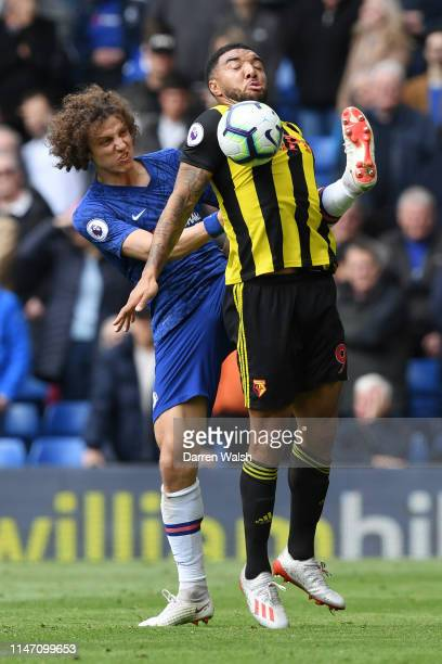 Troy Deeney of Watford shields from David Luiz of Chelsea during the Premier League match between Chelsea FC and Watford FC at Stamford Bridge on May...