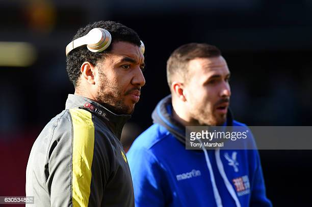 Troy Deeney of Watford speaks with Jordon Mutch of Crystal Palace on the pitch before the Premier League match between Watford and Crystal Palace at...