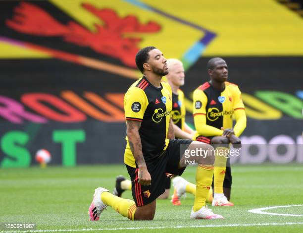Troy Deeney of Watford takes a knee in support of the Black Lives Matter movement prior to the Premier League match between Watford FC and Leicester...