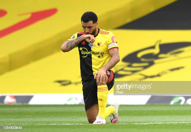 Troy Deeney of Watford takes a knee in support of the Black Lives Matter movement during the Premier League match between Watford FC and Norwich City...