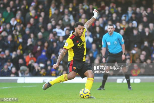 Troy Deeney of Watford takes a penalty kick which is saved by Paulo Gazzaniga of Tottenham Hotspur during the Premier League match between Watford FC...