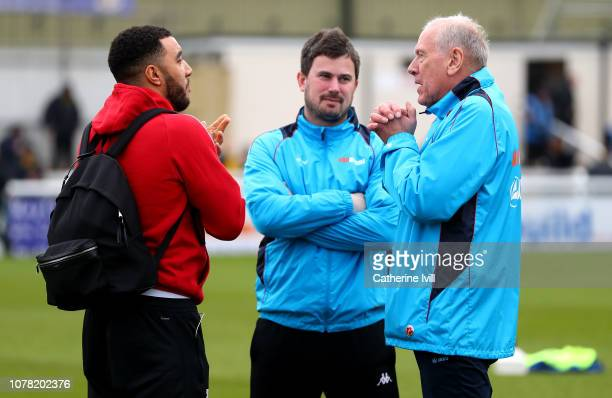 Troy Deeney of Watford talks to Martin Tyler prior to the FA Cup Third Round match between Woking and Watford at Kingfield Stadium on January 6 2019...