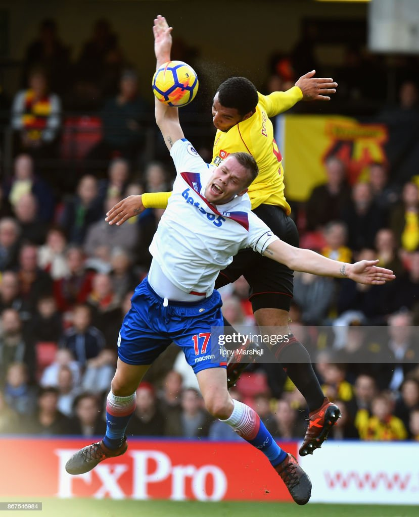 Troy Deeney of Watford wins the ball in the air from Ryan Shawcross of Stoke City during the Premier League match between Watford and Stoke City at Vicarage Road on October 28, 2017 in Watford, England.