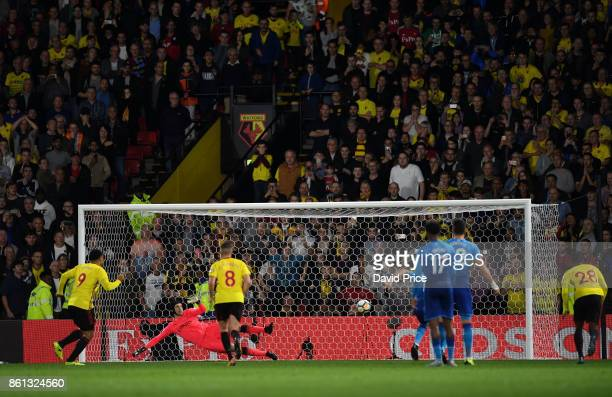 Troy Deeney scores Watford's 1st goal during the Premier League match between Watford and Arsenal at Vicarage Road on October 14 2017 in Watford...