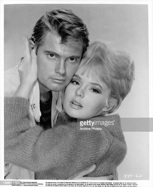 Troy Donahue and Joey Heatherton embrace in a scene from the film 'My Blood Runs Cold' 1965