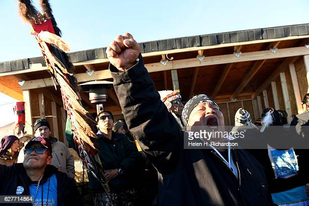 Troy Fairbanks right of the Standing Rock Sioux tribe cheers after hearing Chief Arvol Looking Horse announce to members of over 300 nations that the...