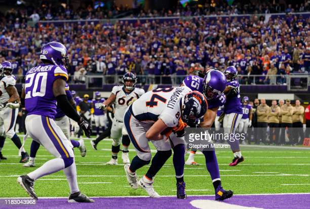 Troy Fumagalli of the Denver Broncos catches the ball for a touchdown in the first quarter of the game against the Minnesota Vikings at U.S. Bank...