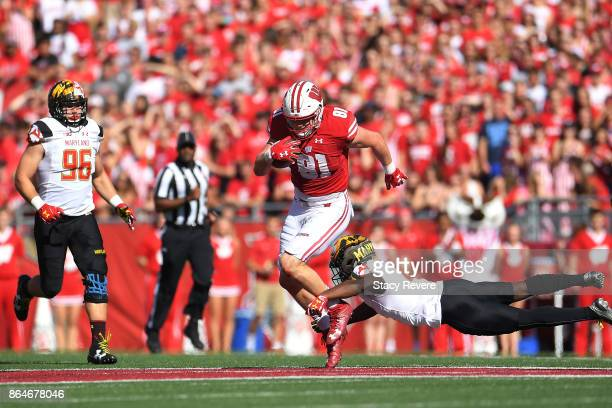 Troy Fumagalli of the Wisconsin Badgers avoids a tackle by Darnell Savage Jr #4 of the Maryland Terrapins during the second quarter at Camp Randall...