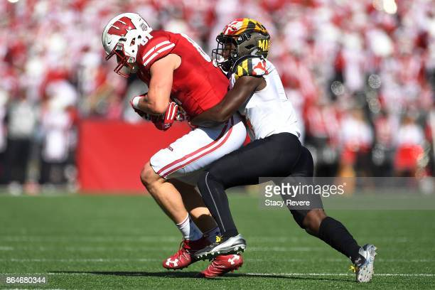 Troy Fumagalli of the Wisconsin Badgers is brought down by Darnell Savage Jr #4 of the Maryland Terrapins during the second quarter at Camp Randall...