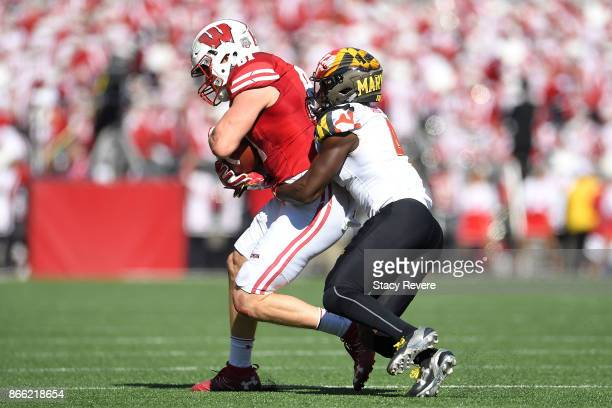 Troy Fumagalli of the Wisconsin Badgers is brought down by Darnell Savage Jr #4 of the Maryland Terrapins during a game at Camp Randall Stadium on...