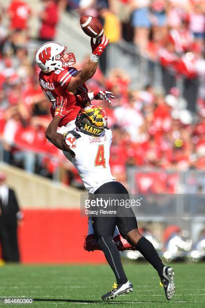 Troy Fumagalli of the Wisconsin Badgers is defended by Darnell Savage Jr #4 of the Maryland Terrapins during the second quarter at Camp Randall...