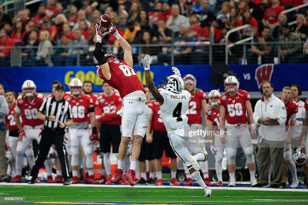 Troy Fumagalli #81 of the Wisconsin Badgers makes a catch over Darius Phillips #4 of the Western Michigan Broncos in the fourth quarter during the 81st Goodyear Cotton Bowl Classic between Western Michigan and Wisconsin at AT&T Stadium on January 2, 2017 in Arlington, Texas.