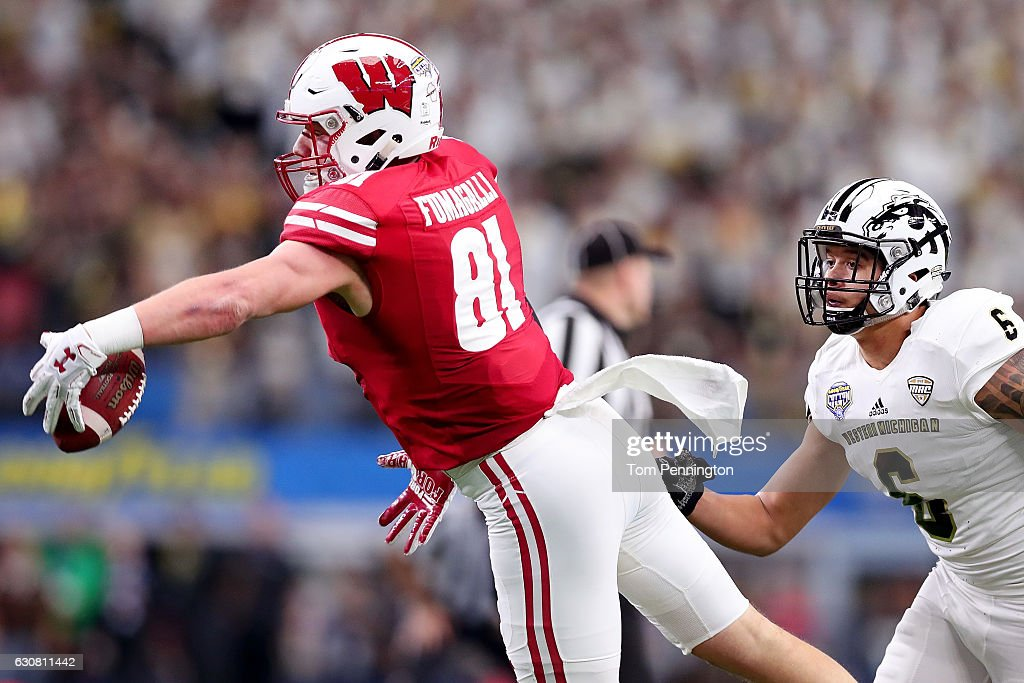 Troy Fumagalli #81 of the Wisconsin Badgers makes a one handed catch against Asantay Brown #6 of the Western Michigan Broncos in the first half at AT&T Stadium on January 2, 2017 in Arlington, Texas.
