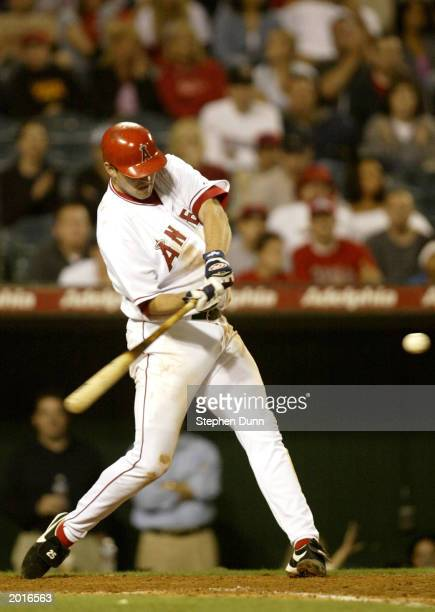 Troy Glaus of the Anaheim Angels hits a double to lead off the ninth inning against the Baltimore Orioles May 20, 2003 at Edison Field in Anaheim,...