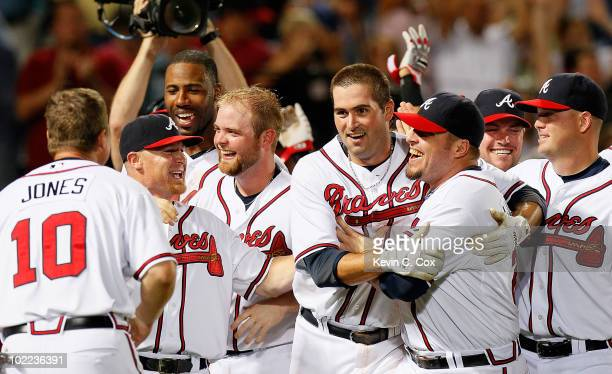 Troy Glaus of the Atlanta Braves celebrates his walkoff homer in the ninth inning to give the Braves a 54 win over the Kansas City Royals at Turner...