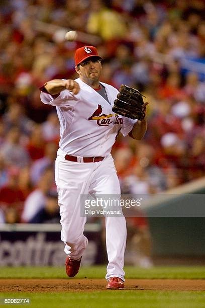 Troy Glaus of the St. Louis Cardinals fields a line drive against the Milwaukee Brewers on July 23, 2008 at Busch Stadium in St. Louis, Missouri.