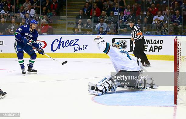Troy Grosenick of the San Jose Sharks makes a save off the shot of Brendan Gaunce of the Vancouver Canucks during Day 3 of NHL Kraft Hockeyville at...