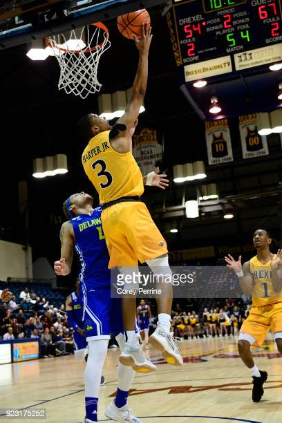 Troy Harper of the Drexel Dragons hits a reverse layup against Darian Bryant of the Delaware Fightin Blue Hens during the second half at the...