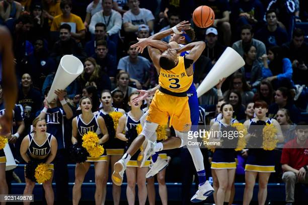 Troy Harper of the Drexel Dragons is called for the offensive foul on Darian Bryant of the Delaware Fightin Blue Hens during the first half at the...