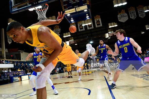 Troy Harper of the Drexel Dragons makes a save against the Delaware Fightin Blue Hens during the second half at the Daskalakis Athletic Center on...