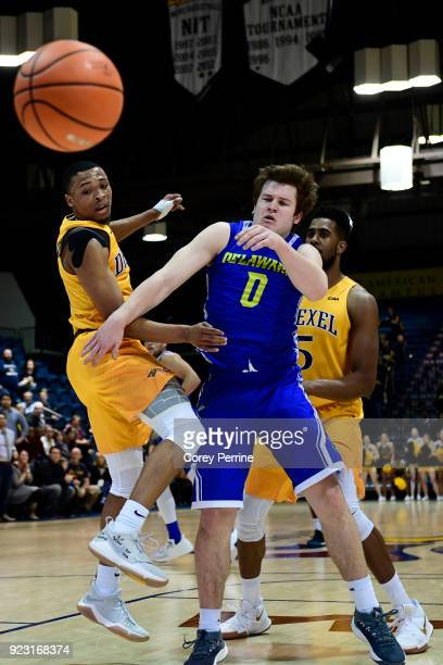 Troy Harper of the Drexel Dragons watches with Ryan Daly of the Delaware Fightin Blue Hens as the ball bounces out of bounds during the second half...